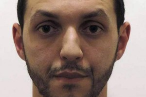 "Police in Belgium have issued an international arrest warrant for Mohamed Abrini, a man linked to the deadly Islamic State Paris attacks, as Brussels on Wednesday begins to normalize after a security crackdown. Abrini -- who is described as ""dangerous and probably armed"" -- is seen in the footage driving the Renault Clio vehicle that was used and then abandoned in the attacks, according to Belgian authorities. Photo courtesy of Belgian Federal Police"