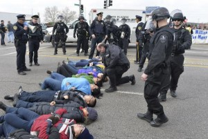 """Two people glued themselves to the gate of an immigration detention center near London's Heathrow Airport in an attempt to block a deportation flight from the United Kingdom to Africa. The Unity Center organized the protest and called for """"urgent action"""" against the deportation, urging the public to contact the airport to """"show opposition."""" Pictured: Police inform protesters blocking traffic on a major street near the Immigration and Customs Enforcement detention facility that they will be arrested if they do not move on April 8, 2014 in Broadview, Ill. The protest was the conclusion of a two-day march from ICE's Chicago office to their Broadview detention facility to protest the Obama administration's deportation policy for illegal immigrants. Eleven protesters were arrested for refusing to clear the street. File photo by Brian Kersey/UPI 