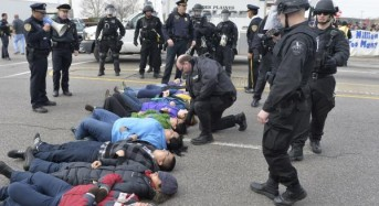 Deportation protesters glue themselves to detention center gate
