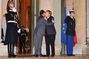 French President Francois Hollande greets German Chancellor Angela Merkel at the Elysee Palace in Paris on November 25, 2015. The two leaders discussed security co-operation and intelligence sharing in light of the recent terrorist attack in the city. Photo by David Silpa/UPI | License Photo