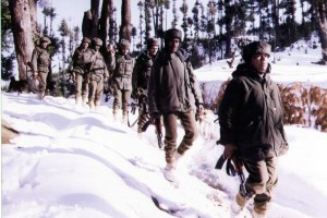 Indian troops patrol the snow-laden mountains along the Pakistani border in Indian-controlled Kashmir on March 11, 2000. On Nov. 28, 2015, militants attacked Indian troops in the Poonch district of Indian-controlled Kashmir. One porter working with the Indian army was injured in the attack, which joined a series of other ambushes by suspected Pakistani infiltrators in the region since Nov. 13. File photo by Harbaksh Singh/ UPI | License Photo