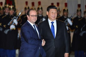 French President Francois Hollande greets Chinese President Xi Jinping at the Elysee Palace in Paris on Nov. 29, 2015. The two leaders will discuss security cooperation in light of the recent terrorist attack in the city as well as issues related to the upcoming climate talks. Photo by David Silpa/UPI | License Photo