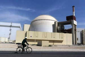 A worker rides his bike past the Bushehr nuclear power plant on Oct. 26, 2010. Construction of the Bushehr plant began in 1975 with the assistance of the German company Siemens. Work was halted, however, after the Iranian Revolution in 1979 and did not resume until several years later, when Russia stepped in to help. The plant became operational in 2012. Photo by Majid Asgarpour/UPI/Mehr News Agency | License Photo