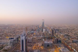 Women in Saudi Arabia were allowed to vote and stand in as candidates Saturday for the first time in the country's history. They still must wear head-to-toe coverings, require male chaperones, and are not permitted to drive. Pictured, the Kingdom Tower business and convention center is seen in Riyadh, Saudi Arabia. Photo by Fedor Selivanov/Shutterstock
