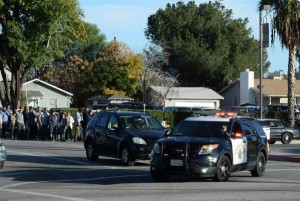 Police block streets as they search for three gunmen who killed at least 14 people in San Bernardino, Calif., on Wednesday. The gunmen opened fire at the Inland Regional Center, a social development center that serves people with development disabilities. Photo by Jim Ruyman/UPI | License Photo