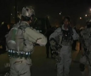 KABUL, Afghanistan, Taliban fighters stormed a guesthouse near the Spanish embassy in the Afghan capital Friday, launching car bombs and possible suicide attacks in the area.