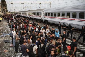 Refugees wait for a train in Tovarnik, Croatia on Sept. 19, 2015. Texas claimed in a lawsuit filed Dec. 3, 2015 that the U.S. government has violated federal law by not consulting with states on matters of resettlement of refugees. Photo by Achilles Zavalli/UPI   License Photo