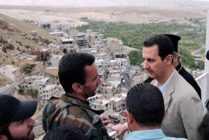 """Syrian President Bashar al-Assad meets with government forces above the town of Maaloua, northeast of Damascus, Syria, on April 20, 2014. Friday, members of the United Nations Security Council approved text of a draft resolution to facilitate a """"road map to peace"""" between Assad's regime and opposition forces -- notably the Syrian National Coalition -- which would include transitional talks beginning Jan. 1. Photo by Syria Ministry of Information/UPI 