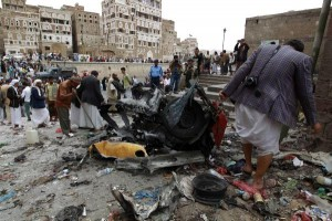 Houthi fighters inspect the wreckage of a car at the site of an attack near of Qubbat al-Mahdi Mosque in Sanaa, Yemen, on June 20, 2015. Yemeni military officials said at least 68 Houthis and government troops were killed during a six-day truce that coincided with peace negotiations. The talks, held in Switzerland, ended without resolution on Dec. 20, 2015. Photo by Mohammad Abdullah/UPI | License Photo