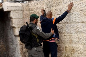 The New Year's Day shooting at a Tel Aviv bar is the latest in three months of near daily attacks by Palestinians in Israel. Israeli security forces have stepped up security checks since September, seen above on October 23, 2015, patting down a Palestinian outside the Demascus Gate ahead of Muslim Friday prayers. Photo by Debbie Hill/ UPI | License Photo