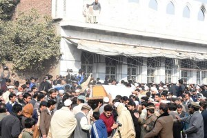 A crowd gathered outside the military-run school building where Taliban insurgents killed more than 140, in northwest Pakistan on December 16, 2014. The group has increasingly staged attacks as Afghanistan and Pakistan have increasingly worked toward peace. Photo by News Lens Pakistan