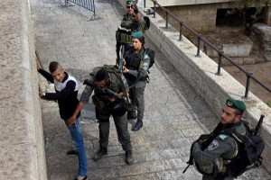 The New Year's Day shooting at a Tel Aviv bar is the latest in three months of near daily attacks by Palestinians in Israel. Israeli security forces have stepped up security checks since September, seen above on October 23, 2015, patting down a Palestinian outside the Demascus Gate ahead of Muslim Friday prayers. File Photo by Debbie Hill/UPI | License Photo