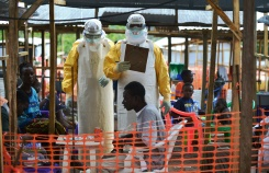 A medical worker relays Ebola patient details and updates to a colleague at an MSF facility in Kailahun, on August 15, 2014
