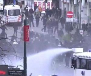 Brussels police use water cannon on memorial protesters
