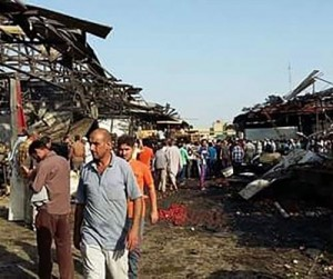 Death toll in Baghdad Shiite market suicide blasts rises to 70