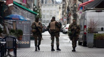 Officers shot in Brussels counter-terrorism raid linked to Paris attacks