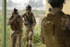 Iraqi-forces-rIraqi soldiers with the 4th Battalion, 23rd Iraqi Army Brigade, move in to detain a notional enemy soldier during a skills evaluation at Camp Taji, Iraq, on March 28, 2016. The soldiers took part in the training as to evaluate their proficiency in basic combat tasks. The army, as part of a coalition, began an offensive to retake Fallujah from the Islamic State on Monday and Iraq recently seized a key town about 10 miles from the city. File Photo by Sgt. Paul Sale/U.S. Army | License Photoetake-town-of-Karma-from-Islamic-State-close-in-on-Fallujah