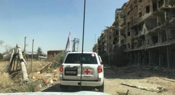 Aid arrives in Damascus suburb; humanitarians say it's not enough