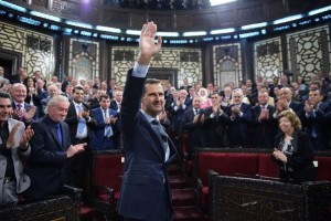 """Syrian President Bashar Assad waves after speaking to the Syrian parliament in Damascus on Tuesday. During his speech, Assad stressed that """"we will liberate every inch of Syria"""" from the terrorists. Photo courtesy of SANA"""