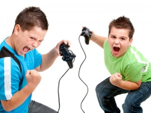Two boys with victorious face expressions playing with video consoles. Isolated on white.