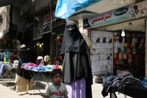 Vendors sell in the rebel-held Bustan al-Qasr district in eastern Aleppo, Syria, on May 21. Organizations are attempting to deliver humanitarian aid after a cease-fire started at sundown Monday. File photo by Ameer Alhalbi/ UPI | License Photo