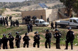 Israeli police special forces stand guard after demolishing houses in the unrecognized Bedouin village of Umm al-Haran, in the Negev, near the southern city of Beer Sheva, Israel on Wednesday. Violent clashes resulted in the death of a police and of a local resident, with protesters calling for an investigation into what caused the fatal encounter. Photo by Debbie Hill/UPI | License Photo