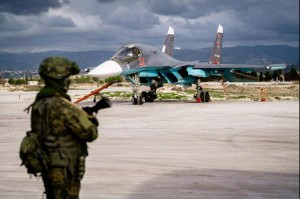 A Russian Air Force fighter jet sits on a runway at Russia's Khmeimim Air Base in western Syria. On Wednesday, Russia and Turkey carried out their first joint coordinated airstrikes against Islamic State targets in Syria. Photo courtesy of Russian Ministry of Defense