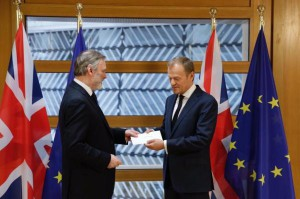 British Ambassador to the European Union Tim Barrow hands over a letter to EU Council President Donald Tusk written by British Prime Minister Theresa May in which she triggered Article 50 of the Lisbon Treaty, which gives Britain and the EU two years to reach an agreement on Britain's departure from the EU. Photo courtesy EU Council