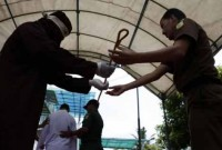 Two Indonesian men receive 83 lashings each for gay sex