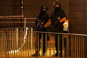 Armed police officers stand next to a police cordon outside the Manchester Arena, where U.S. singer Ariana Grande had been performing, in Manchester, northern England, Britain, May 23, 2017. REUTERS/Andrew Yates