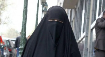 Quebec's new law bans facial coverings by public workers, on buses