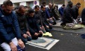 France to stop Muslims praying in the street, interior minister says