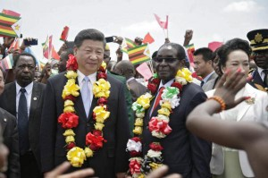 Chinese President Xi Jinping (L) and Zimbabwean counterpart Robert Mugabe (R) maintained close relations until the coup that placed Mugabe under house arrest this week. File Photo by Aaron Ufumeli/EPA