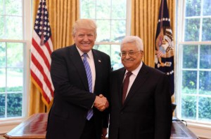 President Donald Trump poses for a handshake picture with President Mahmoud Abbas of the Palestinian Authority in the Oval Office of the White House on May 3. The PA has officially suspended contact with the United States after the Palestine Liberation Organization's office was closed in Washington. Photo by Thaer Ghanaim/UPI | License Photo
