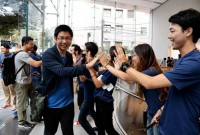 To heavy fanfare, Apple iPhone X goes on sale worldwide