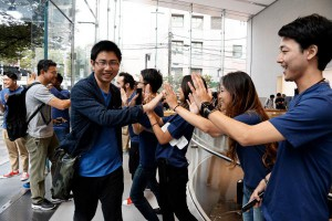 Customers are welcomed by employees at the Apple store in Tokyo, Japan, on Friday. Photo by Keizo Mori/UPI | License Photo