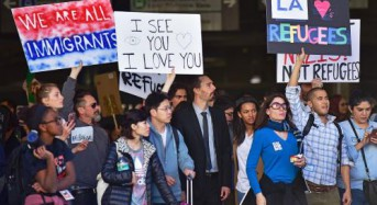 Federal judge partially lifts Trump ban on certain refugees