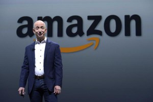 Amazon CEO Jeff Bezos talks about the Kindle products in Santa Monica, Calif., on September 6, 2012. On Friday, the company agreed to settle a $118 million tax bill in Italy. File Photo by Phil McCarten/UPI | License Photo