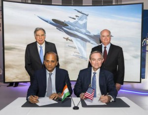 Sukaran Singh, CEO of Tata Advanced Systems Limited, (seated left) and George Standridge, vice president of Strategy and Business Development, Lockheed Martin, agree to produce the F-16 Block 70 in India. Lockheed Martin saw a 10 percent increase in sales in 2016, according to data released today. File Photo by PRNewsfoto/Lockheed Martin Aeronautics Com