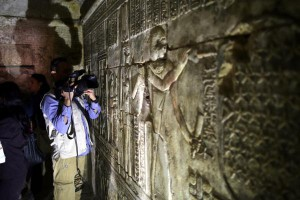 A camera operator takes a video inside Hatshepsut Temple during the opening of the Main Sanctuary of Amun-Re in Hatshepsut Temple at Deir al-Bahary in Luxor's west bank of Egypt. This temple is part of two new tombs discovered, the Egyptian government announced Saturday. Photo by Khaled Elfiqi