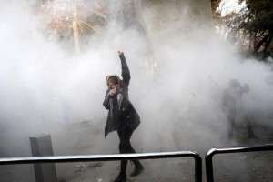 Iranian students clash with riot police during an anti-government protest around the University of Tehran, Iran. Photo by EPA