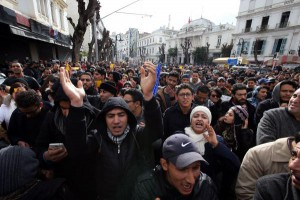 Tunisian protesters shout slogans during a demonstration Friday after the government announced tax hikes and increased prices of some goods in Tunis, Tunisia. Photo by Mohamed Messara/EPA
