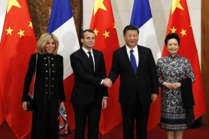 French President Emmanuel Macron (2-L) and his wife Brigitte Macron (L) are welcomed by Chinese President Xi Jinping (2-R) and his wife Peng Liyuan (R) before a meeting at the Diaoyutai State Guesthouse in Beijing, China, on Monday. Pool Photo by Andy Wong/EPA-EFE