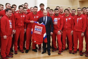 Russian President Vladimir Putin holds a jersey reading 'Russia in my heart' during a meeting Wednesday with Russian athletes and team members. Photo by Grigory Dukor/EPA
