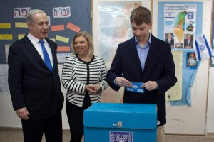 Israeli Prime Minister Benjamin Netanyahu votes with wife Sara and son Yair at a polling station on election day in 2013. File photo by Uriel Sinai/EPA