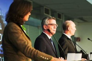 German State Minister Ilse Agnier, L, Interior Minister Thomas de Maziere, C, and cybersecurity agency ZITiS chief Wilifred Karl, R, address a press conference in September 2017. On Wednesday the government acknowledged that its foreign and defense ministries were victims of cyberattacks. Photo courtesy of German Interior Ministry