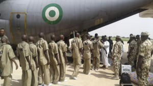 Boko Haram militants are loaded onto an aircraft by the Nigerian military to be taken to a rehabilitation center in Gombe where they reportedly are to begin a de-radicalisation process, in Maiduguri, Nigeria, on July 8,. The terror group may have abducted more than 100 school girls after a raid Monday. File Photo by Usuf Osman/EPA
