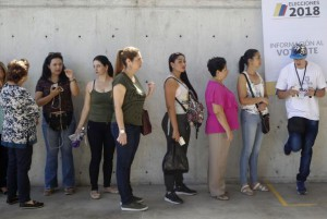 People line up to vote in the legislative election in Medellin, Colombia. Photo by Luis Eduardo Noriega/EPE-EFE