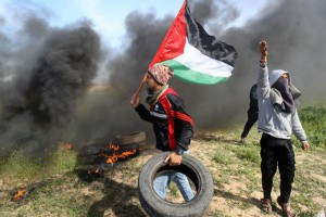 Palestinian protesters arrange burning tires during clashes with Israeli forces near Khan Yunis by the border between Israel and the southern Gaza strip on Friday. The protests are against President Donald Trump's announcement to recognize Jerusalem as the capital of Israel and plans to relocate the U.S. Embassy from Tel Aviv to Jerusalem. Photo by Ismael Mohamad/UPI | License Photo