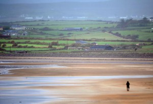 A man walks along a beach in County Clare along the Atlantic Seabord of Ireland on October 16, 2017. Next month, Ireland's first nude beach will open south of Dublin. File Photo by Aidan Crawley/EPA-EFE